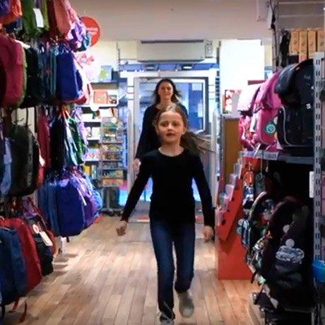 Emilja is choosing her new schoolbag